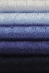 Blue toned spools of threads background