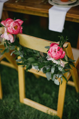 Floral garland on chairs at wedding