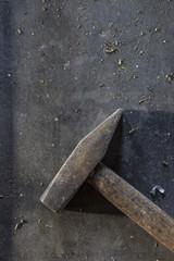 Hammer on dark metal background