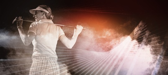 Composite image of woman playing golf