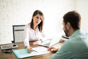 Woman sealing a deal with client