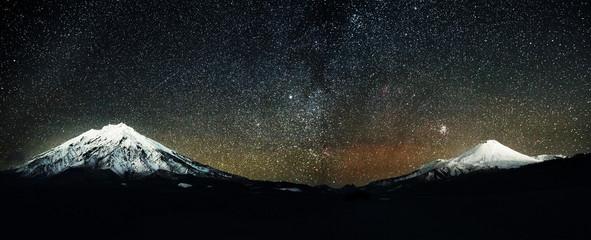 Avachinskiy and Koryakskiy volcano at night with stars at night sky, Kamchatka, Russia