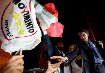 5-Star Movement member Alessandro Di Battista shakes hands to supporters in front of the Montecitorio government palace in Rome