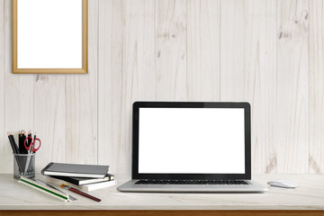 Stylish workplace mockup. home office workspace with laptop computer, office supplies  at home or studio office. Mock up blank screen for graphic montage.
