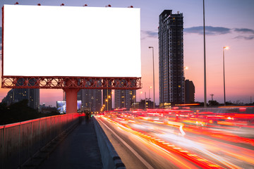 Blank billboard on light trails, street and urban in the twilight - can advertisement for display or montage product or business.