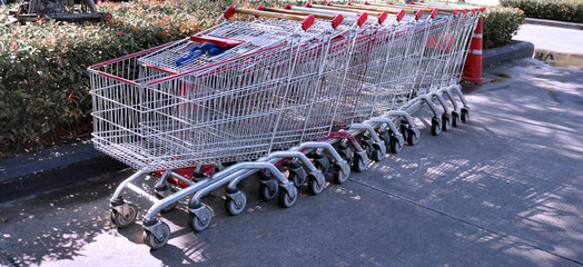 A Row of Empty Shopping Carts Parking Outside