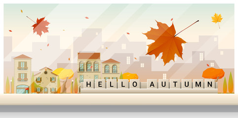 Letters spelling hello autumn on wooden table top with autumn cityscape background , vector , illustration