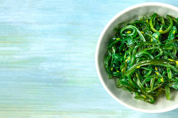 Plate of wakame, sea vegetable, with copy space