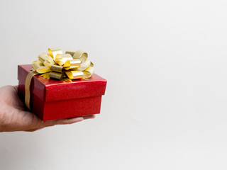 Valentine festival , New year Gold gift box with red ribbon. Red background for create idea copy space.