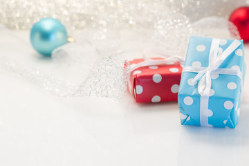 Gifts boxes with ribbons on white background