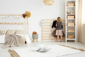 Girl in scandinavian style bedroom