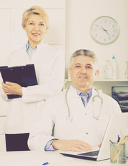 Doctor and nurse waiting for patients