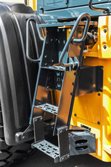 stairs with steps on the tractor. details of construction equipment and transport
