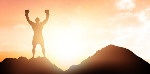 Composite image of portrait of winning boxer with arms raised