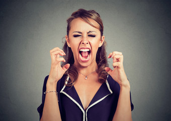 Angry frustrated woman screaming