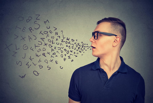 Man in glasses talking with alphabet letters coming out of his mouth. Communication concept