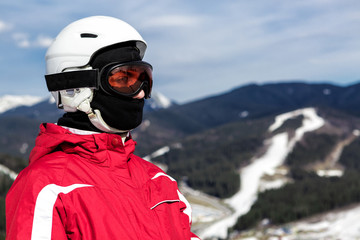 skier standing on top of a mountain