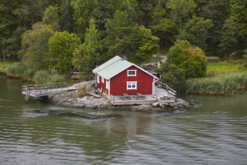 Garden Poster Scandinavia Traditional finnish red wooden house. Lake shore. Finland