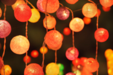 Blurred photo of colorful light cotton balls. Abstract New Year background.