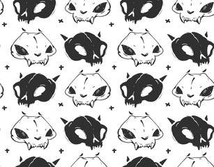 Hand drawn vector abstract artistic freehand textured ink seamless pattern with cat skulls isolated on black background