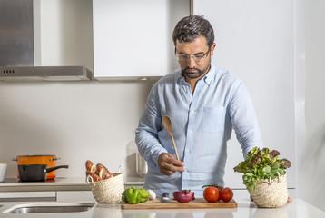 arab man preparing food in his urban apartment
