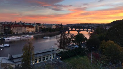 Fototapete - Timelapse view of scenic sunset over bridges on the Vltava River in Prague