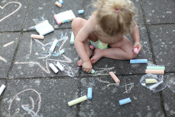 child's drawing on stone terrace, coloured chalk