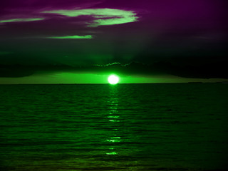 green sunrise when look pass dark green glass protection