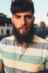 Head and shoulder portrait of bearded man