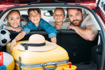 family ready for car trip