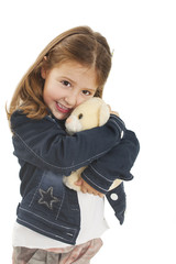 Little girl hugging a teddy bear Isolated on white background