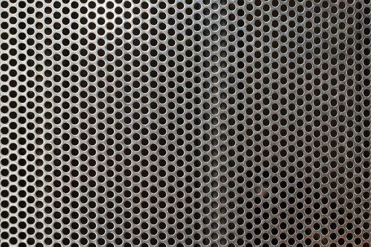 Metal mesh texture background over brushed metal sheet