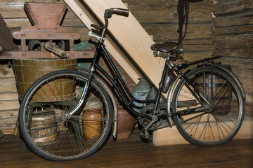 old black rusty bicycle in old country house