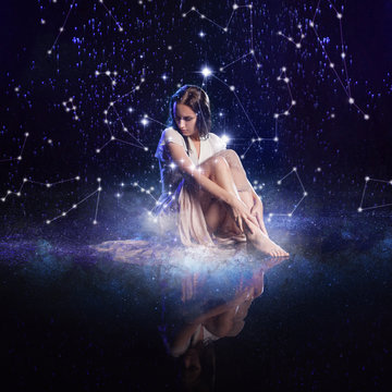 Photo art, young woman dreams to starry sky. Elements of this image furnished by NASA.