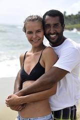 Portrait of happy couple on the beach