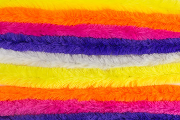 background of multicolored pipe cleaners