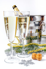 glasses of champagne and Christmas ornaments on white background