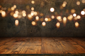 Old concrete wall with bokeh and wooden floor