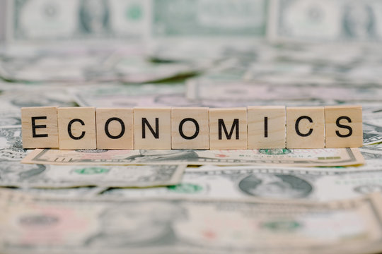 "the word ""ECONOMICS"" written in wooden block letters"