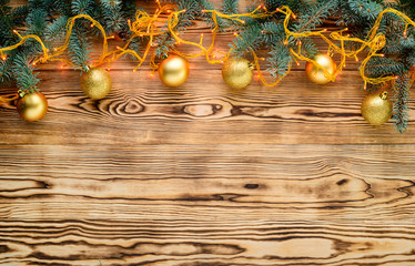 Christmas light background with fir branches and Christmas decorations, copyspace for your text. Top view, flat