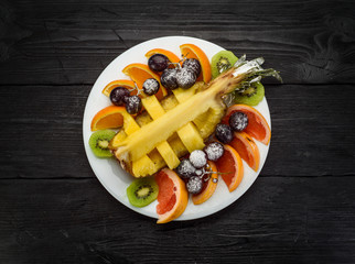 Fruit plate on a dark wooden background
