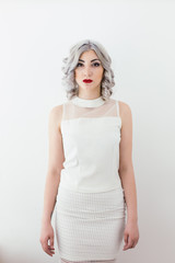 Grey haired fashion young woman portrait in white clothes