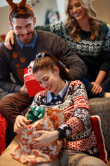 Girl open Christmas gift