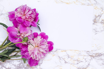 pink peonies on a marble table