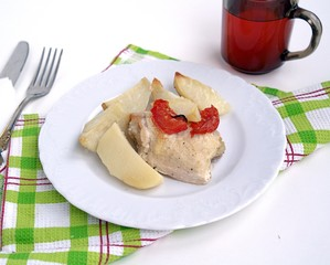 Chicken baked in sour cream sauce, with potatoes and tomatoes