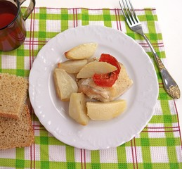 Delicate chicken baked in sour cream sauce with potatoes and tomatoes