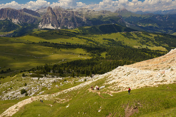 Group of walking tourists in the mountains, Dolomites, Italy