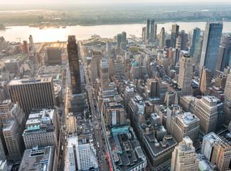 Fototapete - Aerial view of Midtown skyscrapers at night, New York City