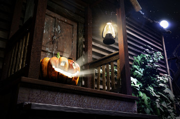 3D illustration of pumpkin on the doorsteps of the old house