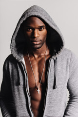 Strong man wearing hoodie with bare chest
